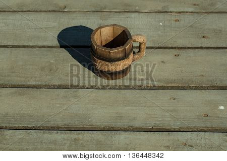 Wooden Mug On The Floor
