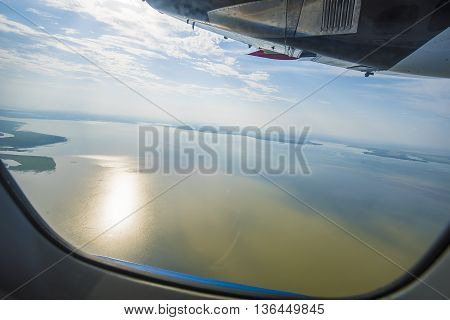 The top view from a window of the flying plane