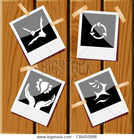 4 images: deer, recycle symbol, bird in hands, bats. Nature set. Photo fframes on wooden desk. Vector icons.
