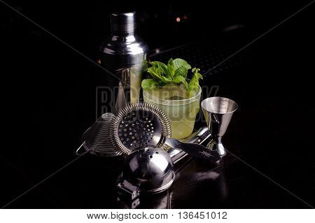 Drink making tools for mojito cocktail lime and mint. black background