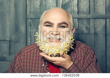 Old Man With Flowers In Beard