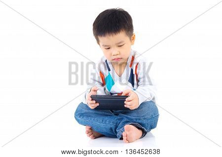 Asian boy playing game on digital tablet