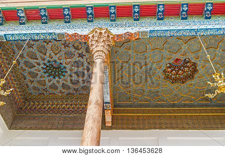 BUKHARA UZBEKISTAN - APRIL 29 2015: The ceiling of Sheikh Nakshbund Mausoleum divided into the different sections with unique carved and painted details on April 29 in Bukhara.