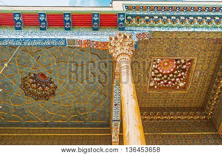 BUKHARA UZBEKISTAN - APRIL 29 2015: The patterns in Sheikh Nakshbund Mausoleum were created and restored with the traditional mineral paints preserved since the Middle Ages on April 29 in Bukhara.