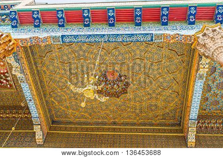BUKHARA UZBEKISTAN - APRIL 29 2015: The carved stellar pattern is covered with colorful floral and geometric ornaments in Sheikh Nakshbund Mausoleum on April 29 in Bukhara.