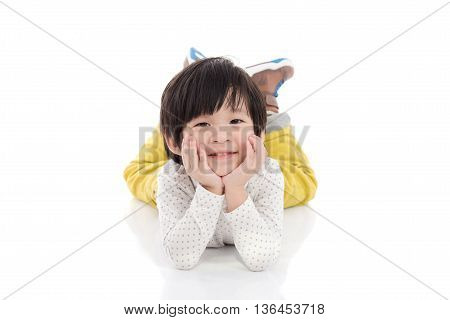 Cute asian boy lying on white background isolated