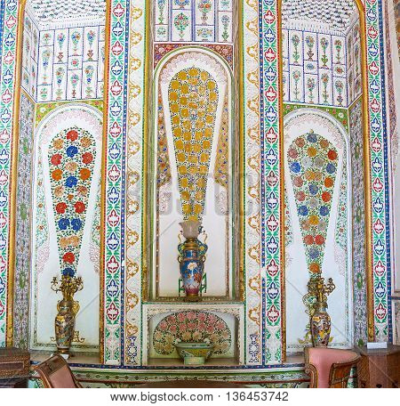 BUKHARA UZBEKISTAN - APRIL 29 2015: The reception room for guests of Sitorai Mokhi-Khosa Palace decorated with the Eastern vases and painted flower bouquets on the wall on April 29 in Bukhara.