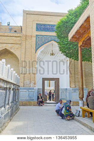 BUKHARA UZBEKISTAN - APRIL 29 2015: The side portal of Sheikh Nakshband Mausoleum in Bahauddin Nakshband Memorial Complex on April 29 in Bukhara.