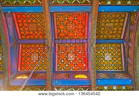 BUKHARA UZBEKISTAN - APRIL 29 2015: The dining room in Sitorai Mokhi-Khosa Palace boasts the stained glass ceiling with colorful geometric patterns on April 29 in Bukhara.