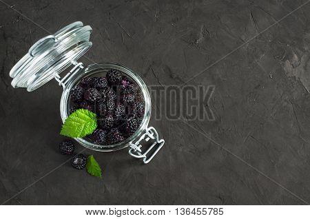 Black Raspberry Or Blackberry In Glass Jar