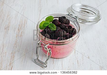Yogurt In A Glass Jar With Black Raspberries