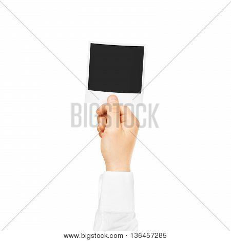 Hand holding blank photo frame mockup. Empty old photography template mock up. Vintage decorative photo design element.
