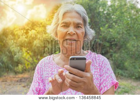 Woman elderly the Using a Smart Phone.