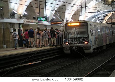 Rome Italy 17 June 2016. Passengers boarding metro at Termini station. Roma Termini is the main railway station.