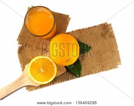 Orange fruit on gunny top view of isolated