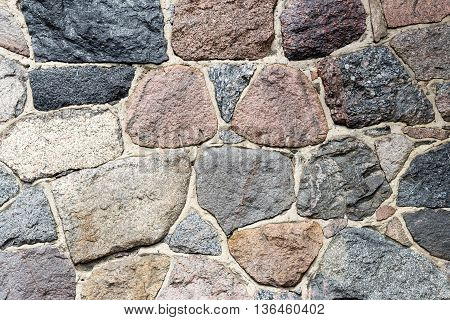 Natural stone block wall background. Abstract pattern.
