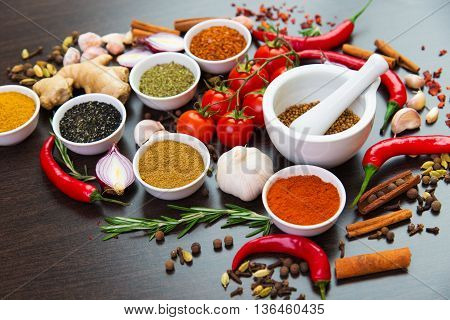 dried and fresh spices on the table the ingredients for cooking