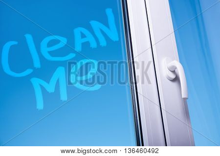 cleaning concept - clean me words on dirty window