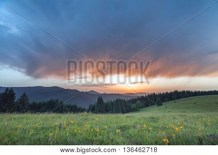 Black stormy sky in the rain in the mountains. Ukraine