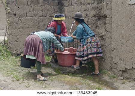 October 22 2012 - Paru Paru Peru: Indigenous women washing chopped raw potatoes in preparation for a traditional wedding ceremony.