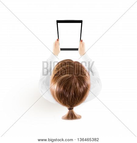 Woman hold tablet pc mockup in hand top view isolated on white. Black mobile ebook mock up holding in female hands from above. Blank tablet screen monitor. Clear vertical display booklet person