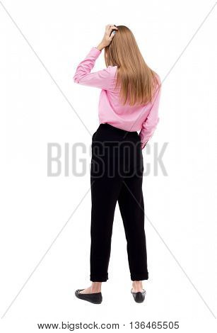 Back view of shocked woman. upset young girl. Rear view people collection.  backside view of person.  Isolated over white background. girl office worker in black pants is holding his head thoughtfully