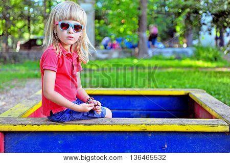 Portrait of a child sitting in the sandbox