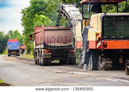 Asphalt Removing Machine Loading Powdered Asphalt On The Truck