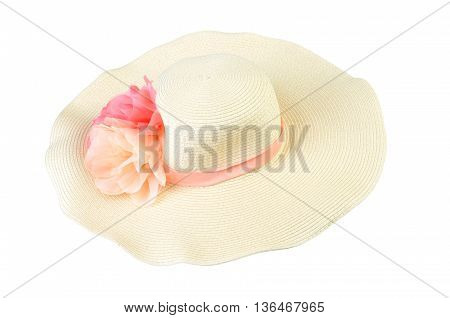 Pretty straw hat with two flowers on white background
