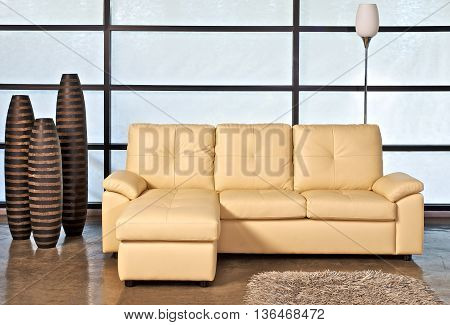 Beige Leather Sofa with Ceramic and Lamp Decorations in Office