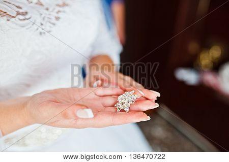 Bride Taking On Hands Stud On Dress