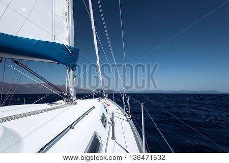 Sailing boat in blue open sea