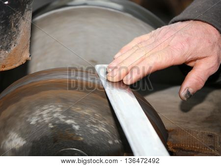 Grinder With Large Hands Sharpen A Blade