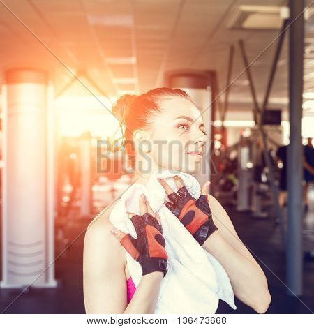 Young Woman Wiping Her Body After Training In Gym