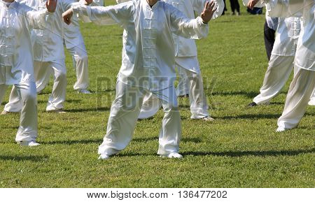 Fans Of Martial Arts Tai Chi With White Silk Dress During The Co