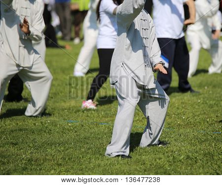Fans Of Martial Arts With Silk Dress During The Concentration Ex