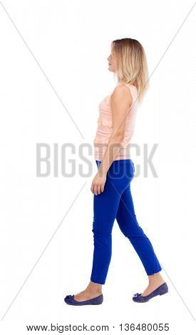 back view of walking  woman. beautiful blonde girl in motion.  backside view of person.  Rear view people collection. Isolated over white background. The blonde in a pink blouse is smiling right.