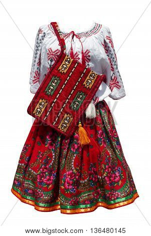 Front view of a Romanian traditional dress with garments and purse isolated on white
