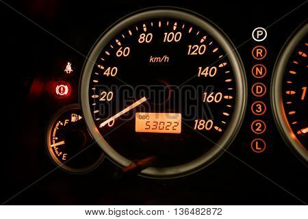 Modern car illuminated dashboard closeup.  Needle, Syringe,