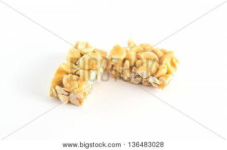 Peanut brittle isolated on white background .