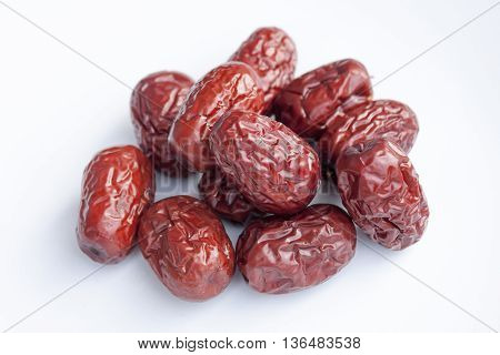 Dried jujube fruits, Chinese dates, which naturally turn red upon drying and Chinese chamomile flowers