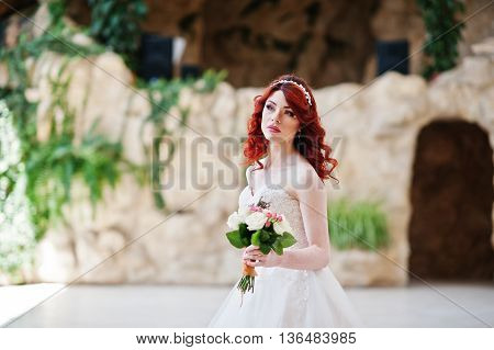 Close Up Portrait Of Charming Red-haired Bride With Wedding Bouquet At Hand Posed At Great Wedding H