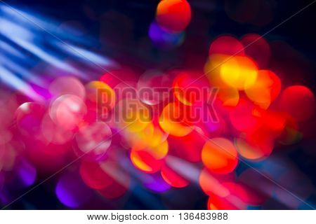 Glitter abstract background with bokeh defocused with natural sun rays.