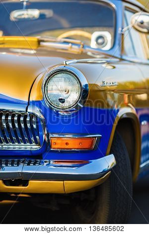 MINSK BELARUS - MAY 07 2016: Volga GAZ 21 - Soviet car of the middle class serially produced at the Gorky Automobile Plant from 1956 to 1970. Close-up photo of the Volga GAZ 21.