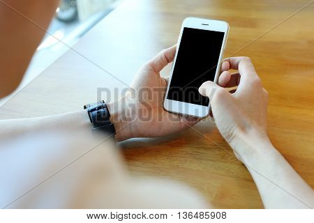 Man holding smartphone with touch on screen