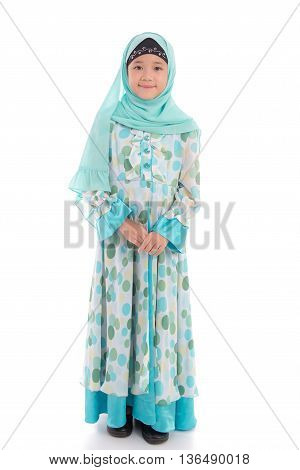 Portrait of asian muslim girl standing on white background isolated