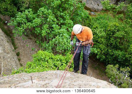 Rappelling a Ferrata in Vadiello, Guara Mountains, Huesca, Aragon, Spain.