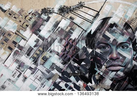 Larnaca Cyprus - May 23 2016: Graffiti with the image of the city and faces on the wall as a background in Larnaca Cyprus