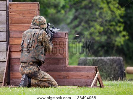 BURG / GERMANY - JUNE 25 2016: german soldier fires with hk g 36 rifle on open day in barrack burg / germany at june 25 2016