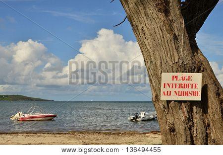 Le Vauclin France - november 13 2015 : beach forbidden for nudist wrote on a sign